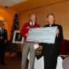 100 Club presents check in the amount of $15,893 for Seminarian Stipends